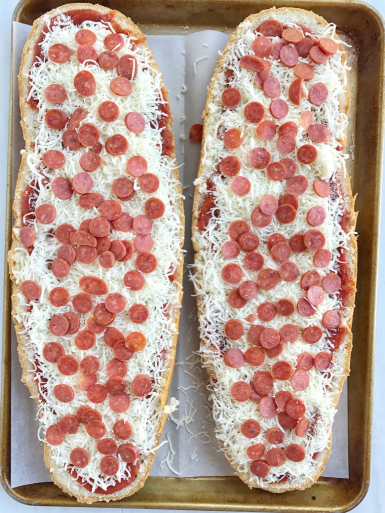 French bread pizza is topped with jazzed up jarred pizza sauce, pepperoni, and lots of cheese. It's a 30 minute dinner that's perfect for a busy weeknight meal.