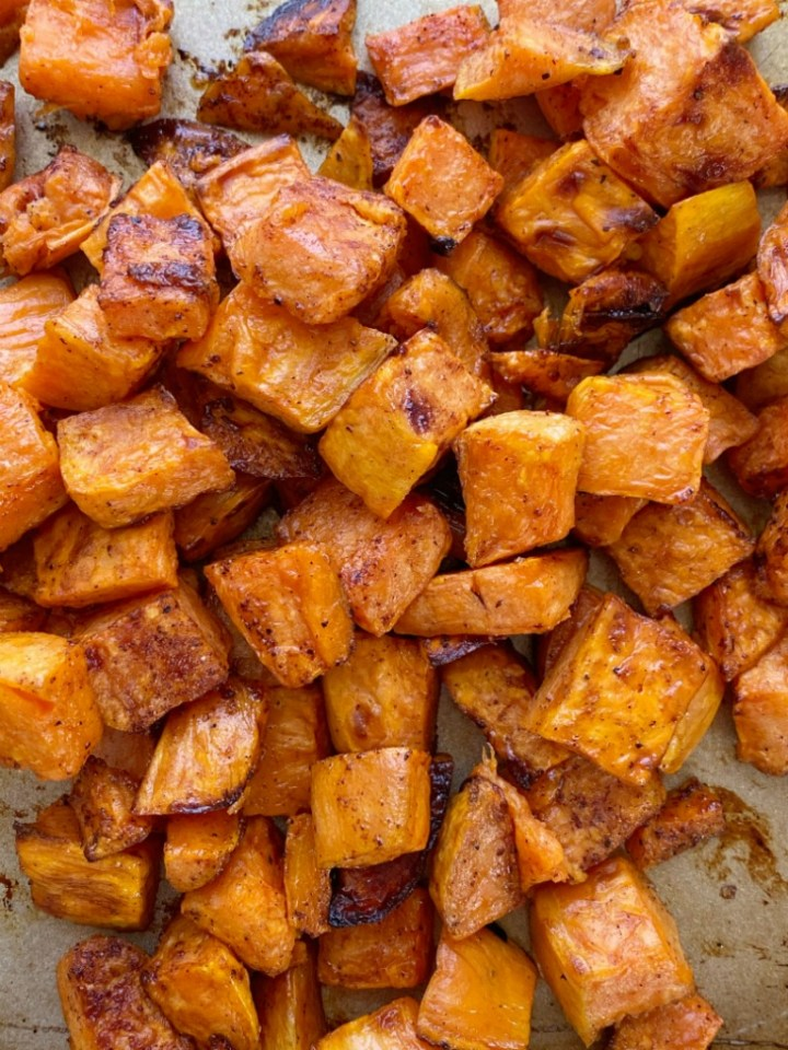 Maple Cinnamon Roasted Sweet Potatoes taste just like sweet potato casserole but healthier! Diced sweet potatoes are covered in a delicious marinade of olive oil, real maple syrup, spices, cinnamon and roasted to perfection in the oven.