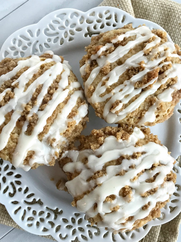Eggnog Crumb Muffins |Soft, tender eggnog muffins with a sweet & buttery cinnamon streusel on top and a simple eggnog glaze. Make good use of seasonal eggnog and make these eggnog crumb muffins. Sure to be a hit and so delicious! | www.togetherasfamily.com #muffins #muffinrecipes #eggnog #eggnogrecipes #eggnogmuffins