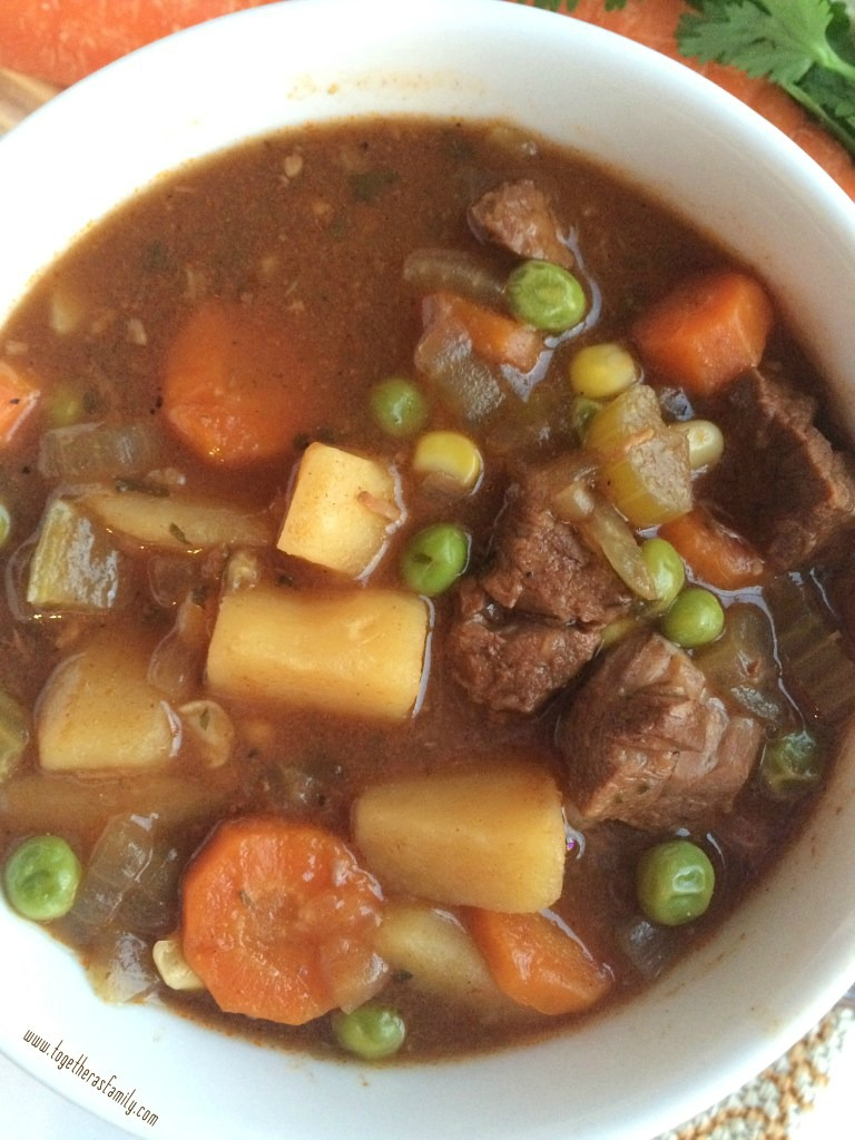 Ultra tender beef, vegetables, and potatoes cooked all day in a flavorful tomato beef broth! This slow cooker beef stew is the ultimate comfort food and it will warm you right up.