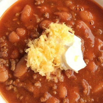 With so many variations of chili the classic version often gets overlooked. Not this one! This is the best classic chili. It's thick, rich, loaded with tomato flavor, lots of beef, and plenty of beans. It's sweet, warm, spicy (in flavor not heat), and so perfect with some sour cream and shredded cheddar cheese.