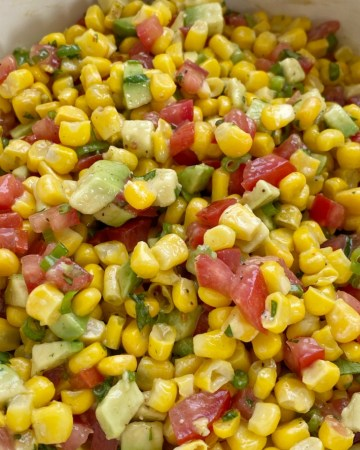 Salsa Recipes   Dip Recipes   Appetizer Recipes   Corn Avocado Salsa   Corn Salsa is the perfect blend of flavor and textures! Creamy avocados, frozen sweet corn, green onion, cilantro, and tomatoes in an easy Italian dressing olive oil vinaigrette. Serve as a healthy side dish, as salsa with tortilla chips, or on top of grilled meats.