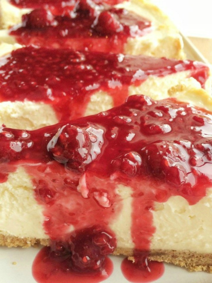 Perfect Cheesecake   How to Make a Cheesecake   Cheesecake Recipe   All the tips & tricks for how to make a cheesecake! Perfectly cooked, no cracks, and not too sweet. You can make your own perfect cheesecake right at home that's so impressive, with my tips and helpful hints. #dessert #dessertrecipe #cheesecake #cheesecakerecipe #raspberrycheesecake
