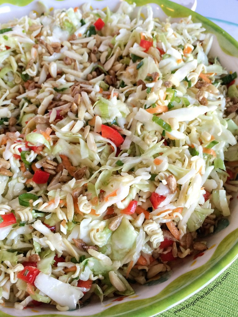 This crunchy ramen salad is full of shredded coleslaw, sweet red pepper, toasted almonds, salty sunflower kernels, green onion, all covered in an easy & sweet olive oil dressing.