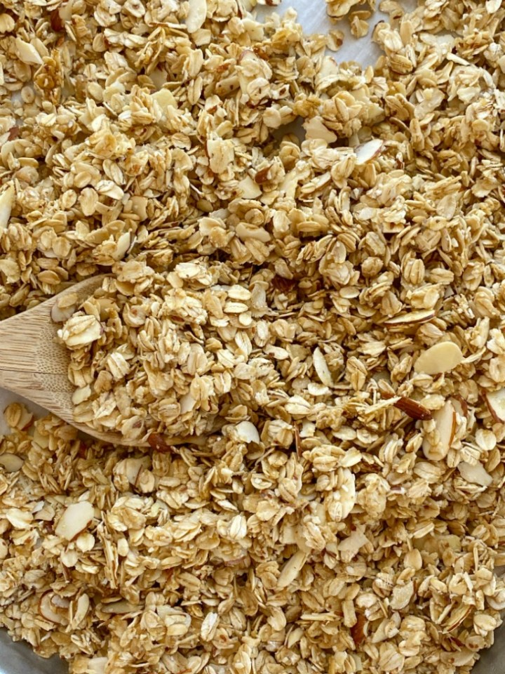 Homemade Coconut Oil Almond Granola uses simple ingredients like whole grain oats and almonds covered in a honey & coconut oil glaze.