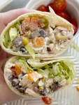 Santa Fe Chicken Salad Wraps have a creamy santa fe chicken salad wrapped inside a tortilla with shredded lettuce, tomato, and avocado slices. Perfect for lunch or a grab & go dinner for busy weeknights.