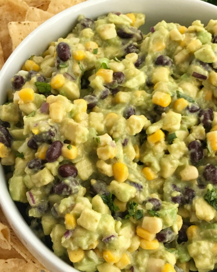 Avocado Dip is packed full with chunky avocados, corn, black beans, red onion, and salsa verde. So easy to make you only need 5 ingredients.