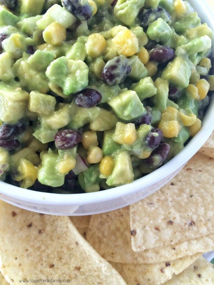 Avocado Dip is loaded with avocados and it's the perfect appetizer for a party or for gameday food! www.togetherasfamily.com