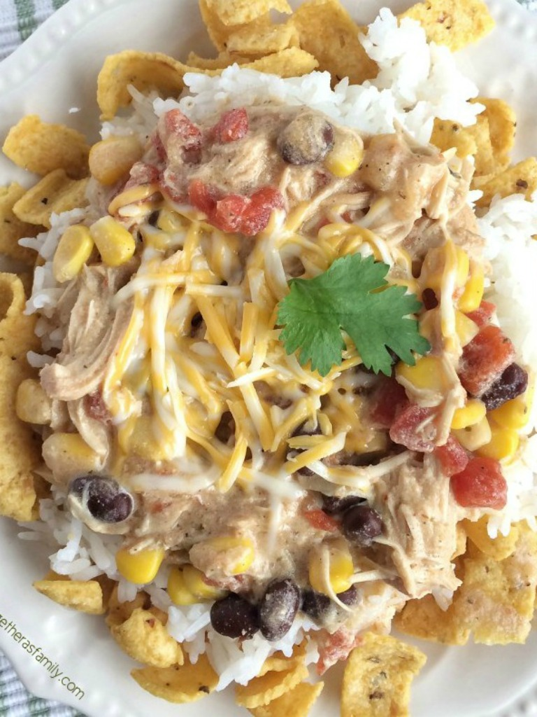 These chicken mexican haystacks are a play on tradition haystacks and have a fun tex-mex twist thanks to the corn chips, beans, corn, and creamy chicken sauce. A fun family dinner where everyone can make their own. Plus, it's made in the slow cooker so dinner can be ready when you need it.
