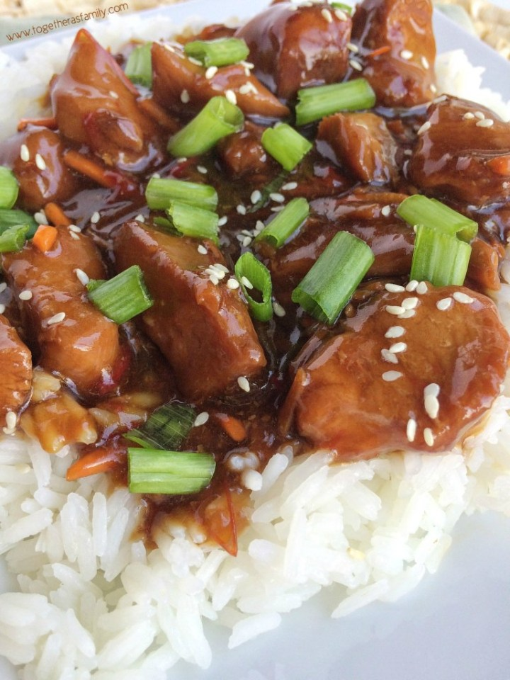 Slow Cooker Mongolian Chicken is a family favorite! Chicken gets cooked to perfection in a flavorful marinade, and shredded carrots and red pepper add some texture and crunch. Serve over some rice and dinner is ready!