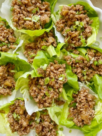 These Chicken Lettuce Wraps taste just like the ones from the famous P.F Changs restaurant. Ground chicken, sesame oil, garlic, ginger, hoisin sauce, water chestnuts, and a touch of brown sugar and hot sauce. Serve with some bib lettuce for the best ground chicken lettuce wrap.