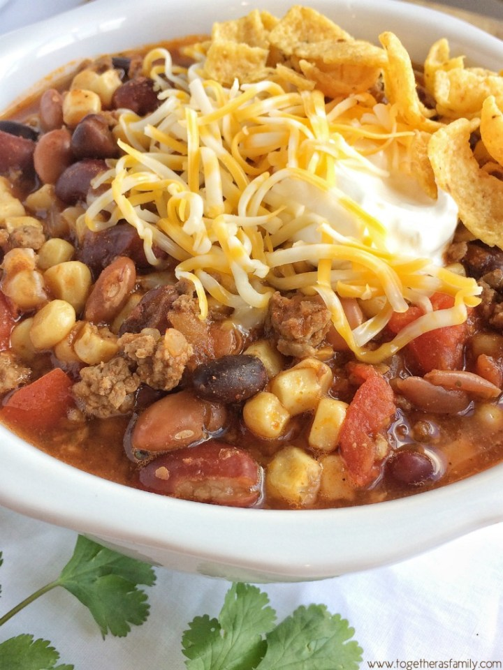 Santa Fe Chili cooks in the crock pot all day and is so hearty and flavorful. Loaded with beef, beans, tomatoes, and corn!