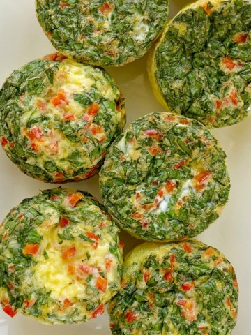 Egg Muffin Cups are the perfect healthy breakfast and you can make these ahead of time for breakfast all week long! Eggs, spinach, red bell pepper, cheese, and seasonings are all you need for this breakfast recipe.