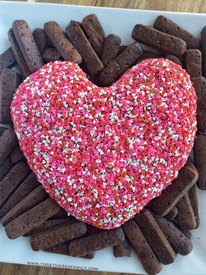 Brownie batter cheesecake sweet dip that is shaped into a heart. Perfect for Valentine's Day!