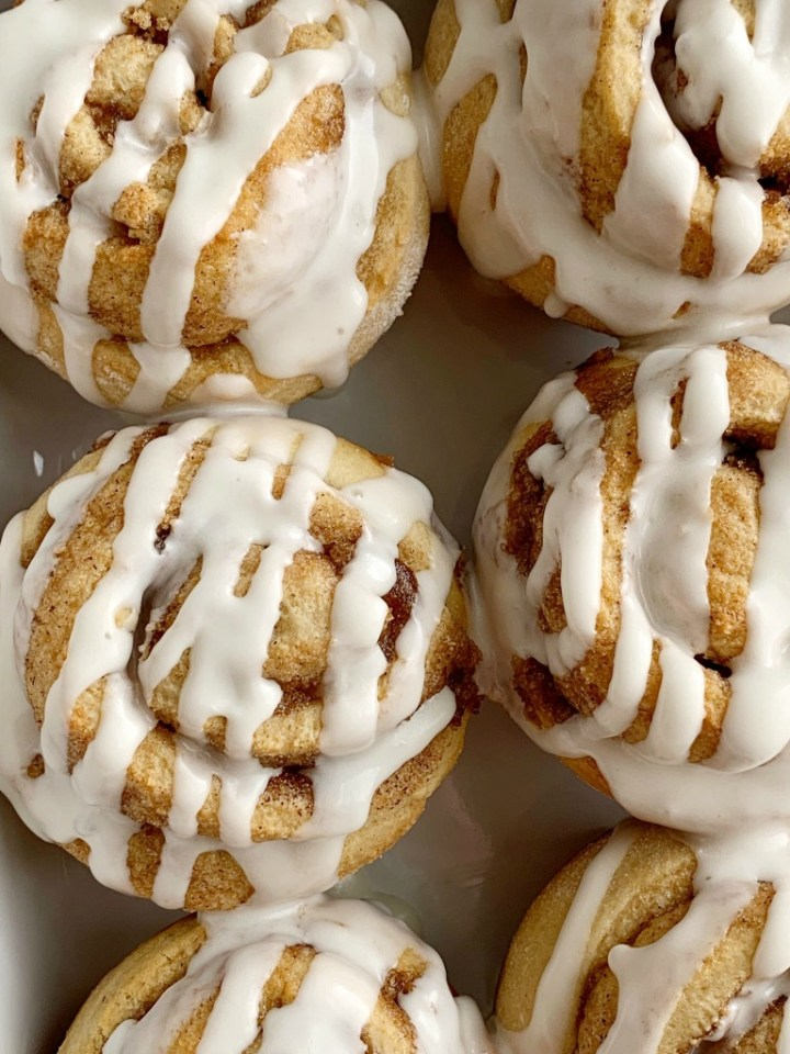 Cinnamon Roll Muffins require no yeast, only one bowl and they're ready in about 30 minutes! All the flavor, gooey cinnamon & sugar, and sweetness that you love about a cinnamon roll, but in an easy to make cinnamon roll muffin recipe.