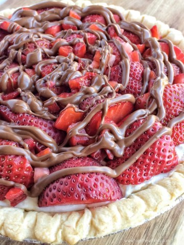 This chocolate strawberry cream pie is a showstopper dessert that no one would believe how easy it is! A simple, 6 ingredient cream pie inside a store-bought cooked crust, and piled high with juicy red strawberries with a milk chocolate drizzle. This pie is the best!