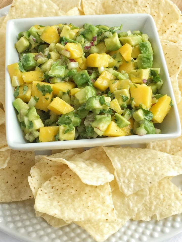 This mango avocado salsa comes together in just minutes. Juicy sweet mangoes, creamy avocado, fresh lime, red onion and cilantro are all you need for the freshest, fastest, and tastiest salsa. Great for a party, appetizer, a snack, or game day food.