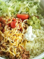 Mexican Haystack Rice Bowls | Dinner | One Pot | Rice Bowls | Mexican haystack rice bowls are a one pot dinner with a flavorful beef mixture seasoned to perfection. Build your rice bowl with cilantro lime rice, seasoned beef, and then pile high with all your favorite toppings. Don't forget the Fritos corn chips. They make this dish spectacular!