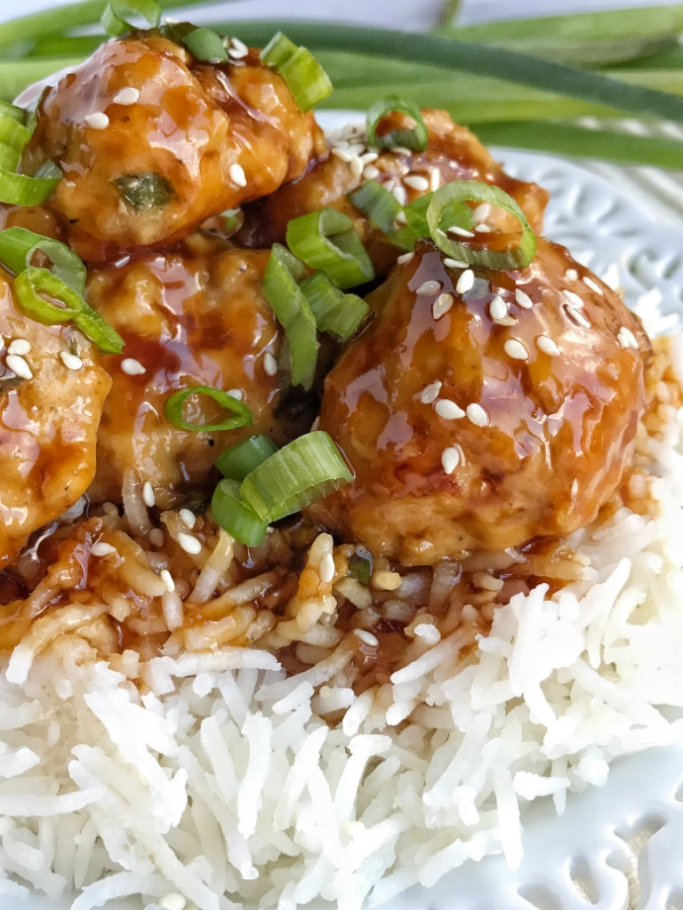 Pineapple teriyaki chicken meatballs are an easy, 30 minute dinner that is made in a skillet pan on the stove top! Tender, flavorful chicken meatballs topped with an easy and quick homemade teriyaki sauce. Serve over rice and garnish with green onions.