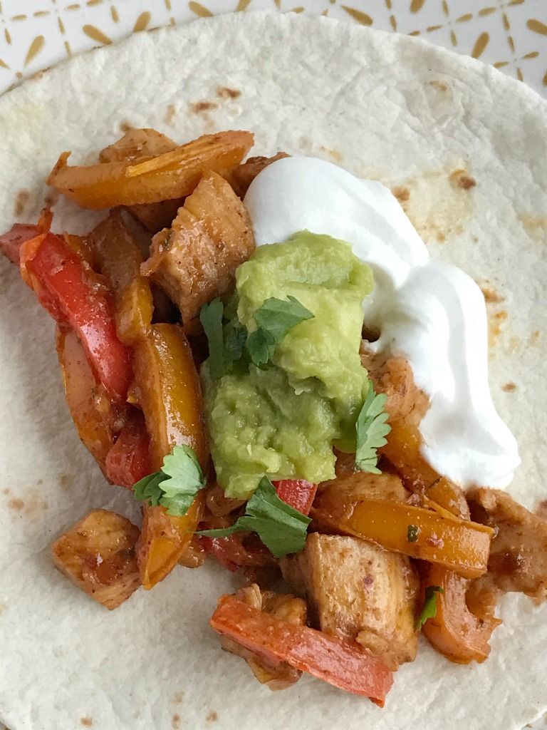 Chunks of chicken, onion, and sliced peppers cook in one pan on the stove top. Mix in some flavorful spices and ranch dressing for the best 30 minute meal. These skillet chicken ranch fajitas are perfect for a busy weeknight.