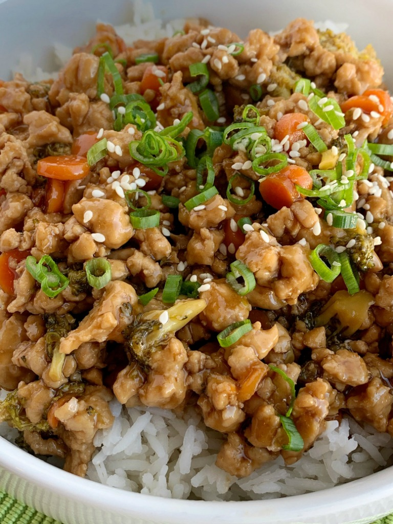 Teriyaki Chicken Rice Bowls | Teriyaki Chicken Recipe | Rice Bowls | Teriyaki chicken rice bowls take 30 minutes to make and are perfect for a busy weeknight dinner. Ground chicken, broccoli, and carrots simmer on the stove top in a delicious and simple teriyaki sauce. Serve over rice and garnish with green onions! #easydinner #dinnerrecipes #chickenrecipes #30minutemeals #teriyakichicken #ricebowls #recipeoftheday