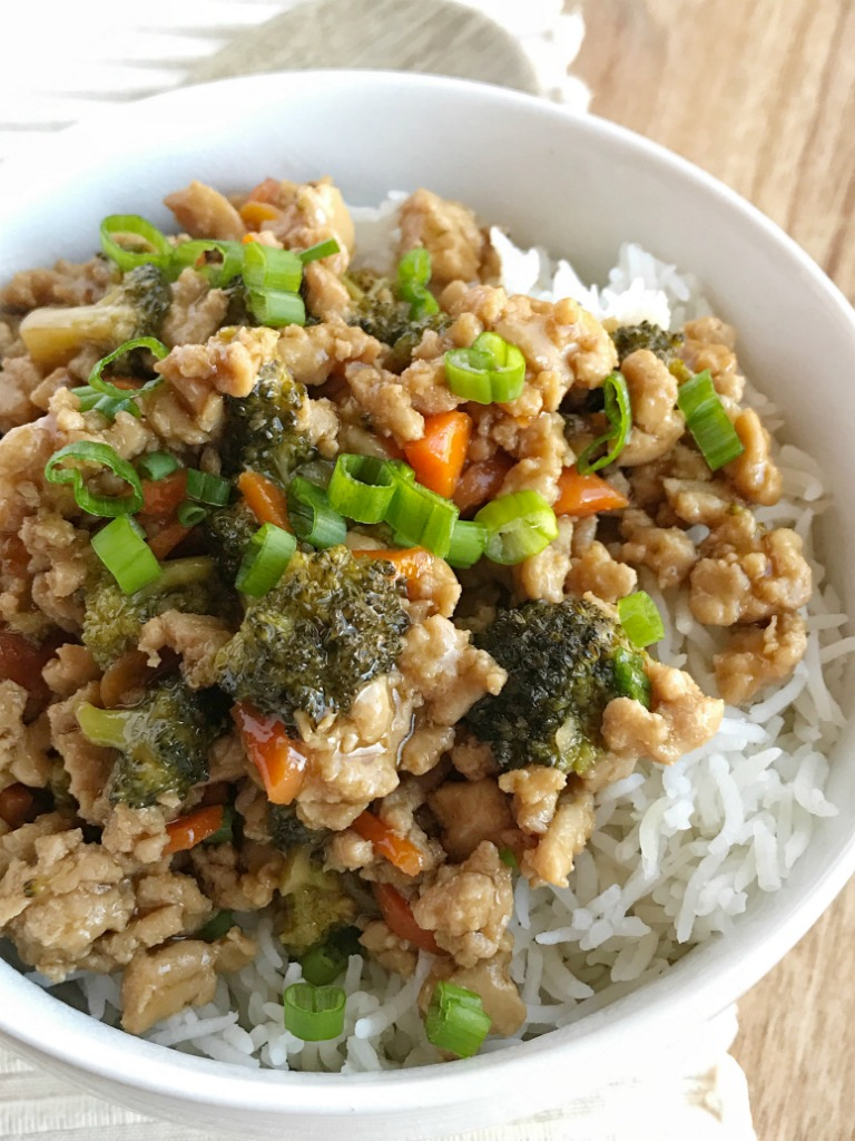 Teriyaki chicken rice bowls are perfect for a busy weeknight dinner. Ground chicken, broccoli, and carrots simmer on the stove top in a delicious and super simple teriyaki sauce. Serve over rice and garnish with green onions! Dinner will be so yummy.