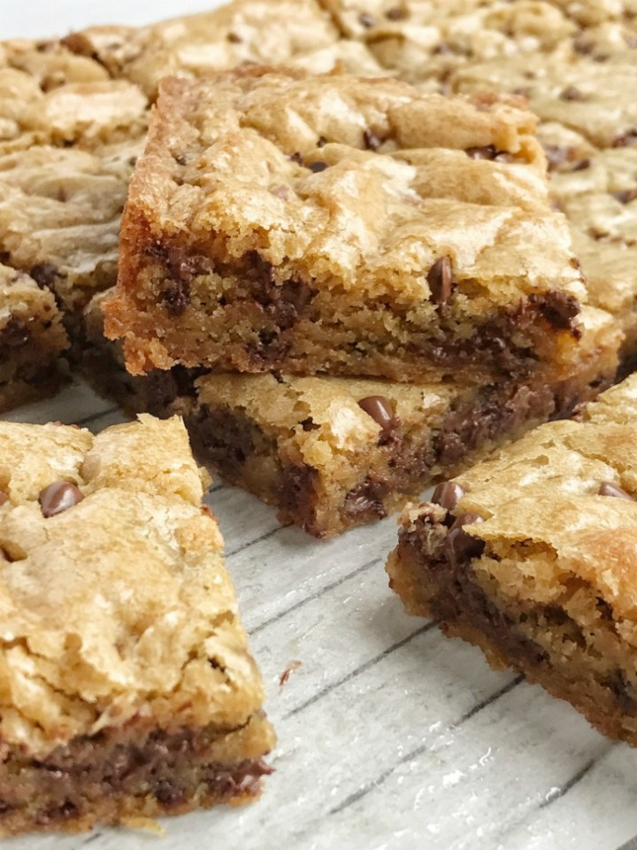 Chocolate chip cookie blondie bars are a chewy cookie bar loaded with chocolate chips and the best dessert! These bars bake in one pan and are so simple to make. Theybake up perfectly sweet & chewy each time with crisp, buttery edges and a super soft middle. If you love chocolate chip cookies then you will want to make these.
