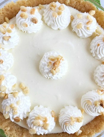 This cool & creamy macadamia nut key lime pie is a no bake dessert that is perfect for hot summer days. A quick crust of shortbread cookies and macadamia nuts filled with a sweet key lime creamy pie. Top with some sweetened whipped cream and dessert is ready!