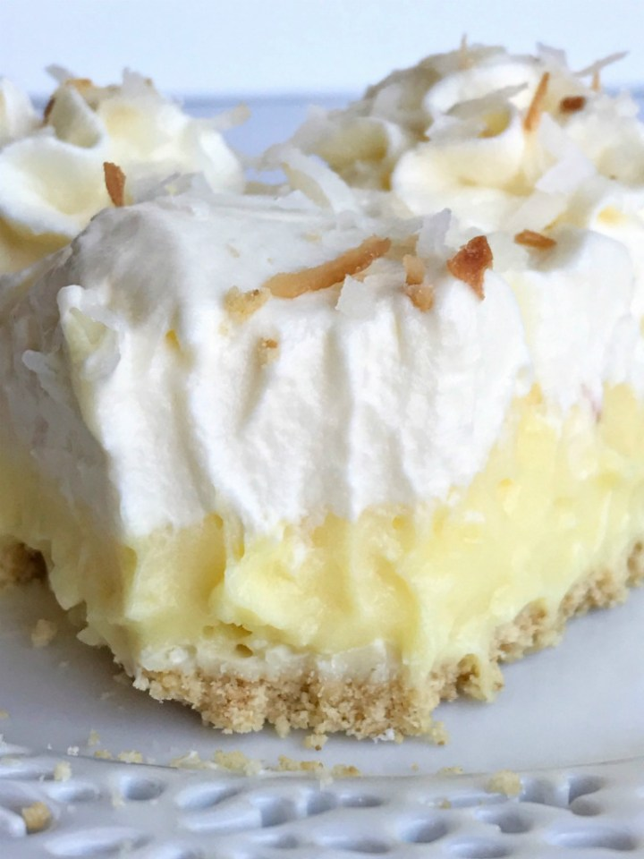 White chocolate coconut cream pie is a no-bake dessert that's made in an easy store-bought shortbread crust. Filled with white chocolate two ways and a creamy coconut pudding filling. Top with toasted coconut and white chocolate curls for a delicious and no bake dessert.