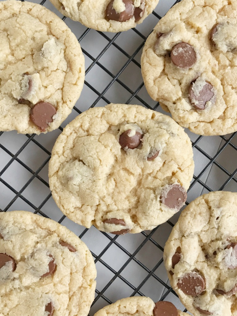 Cream cheese chocolate chip cookies are a fun twist to the classic. No egg needed with these cookies! Soft, sweet, and creamy chocolate chip cookie dough loaded with milk chocolate chips.