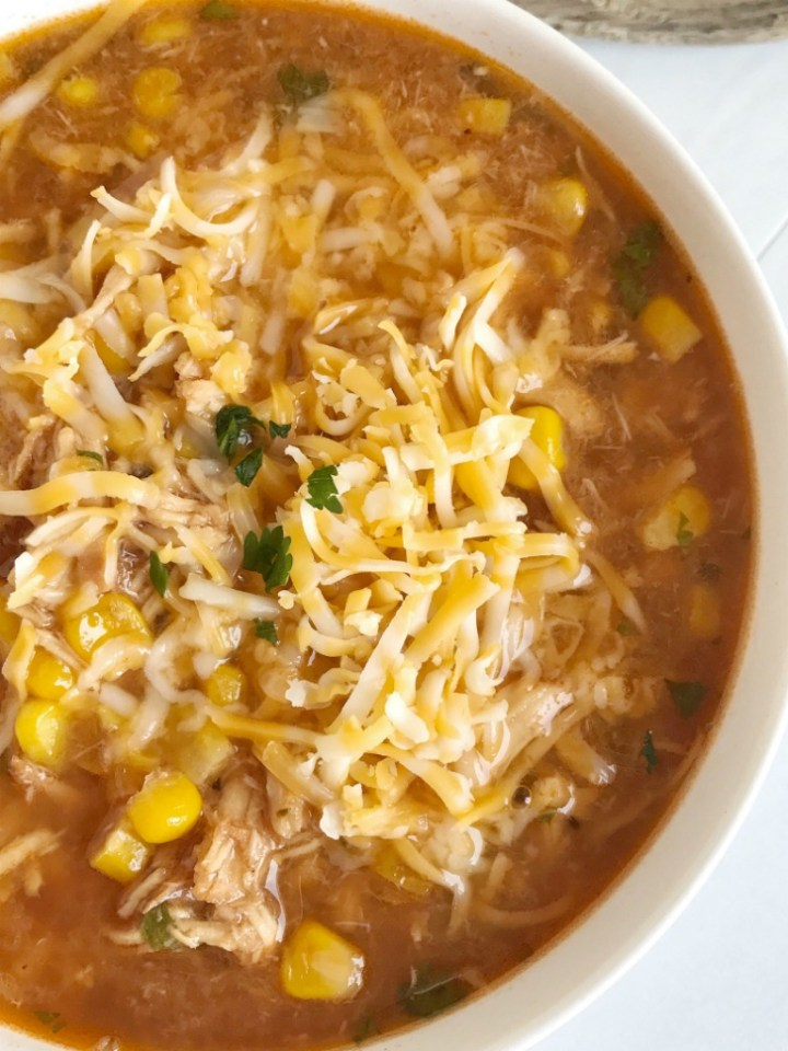 BBQ chicken soup that tastes just like the pizza! Flavorful base of chicken broth and BBQ sauce, loaded with garlic, shredded chicken, roasted corn, and spices. This is a quick & simple dinner and the perfect way to use leftover shredded chicken or BBQ chicken.