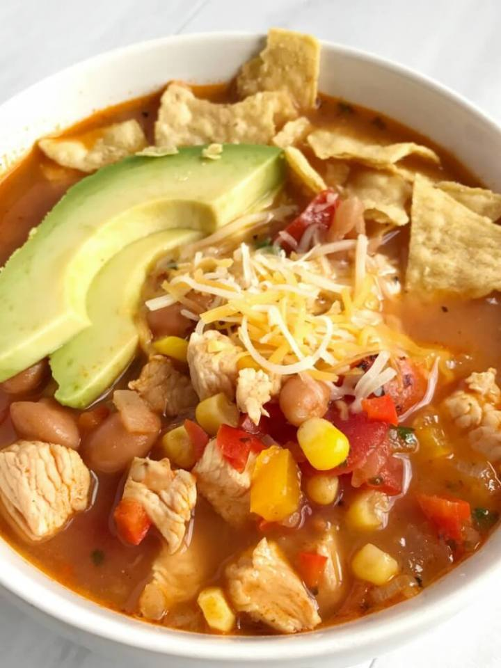 Skinny chicken taco soup only takes 30 minutes to have on the dinner table and it's all cooked in just one pot! Get a healthy, delicious, and comforting dinner on the table in record time and with hardly any dishes. The leftovers make a great lunch for the next day.