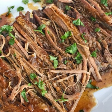 Tender & full of flavor this slow cooker pot roast is comfort food at it's finest. You only need 4 ingredients for the best pot roast ever. Fancy enough for company and easy enough for a weeknight dinner | togetherasfamily.com