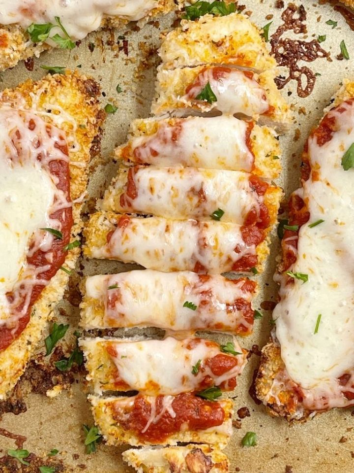Baking sheet with parmesan chicken and cheese.