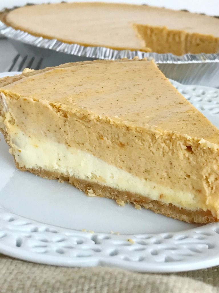 Double layer pumpkin cheesecake pie has two layers of pumpkin cheesecake inside a prepared graham cracker crust. This is an easy cheesecake recipe that even beginners can make. Top with some fresh whipped cream for the ultimate Fall dessert or add it to your Thanksgiving dessert table | www.togetherasfamily.com #pumpkin #pumpkinrecipes #cheesecakerecipes