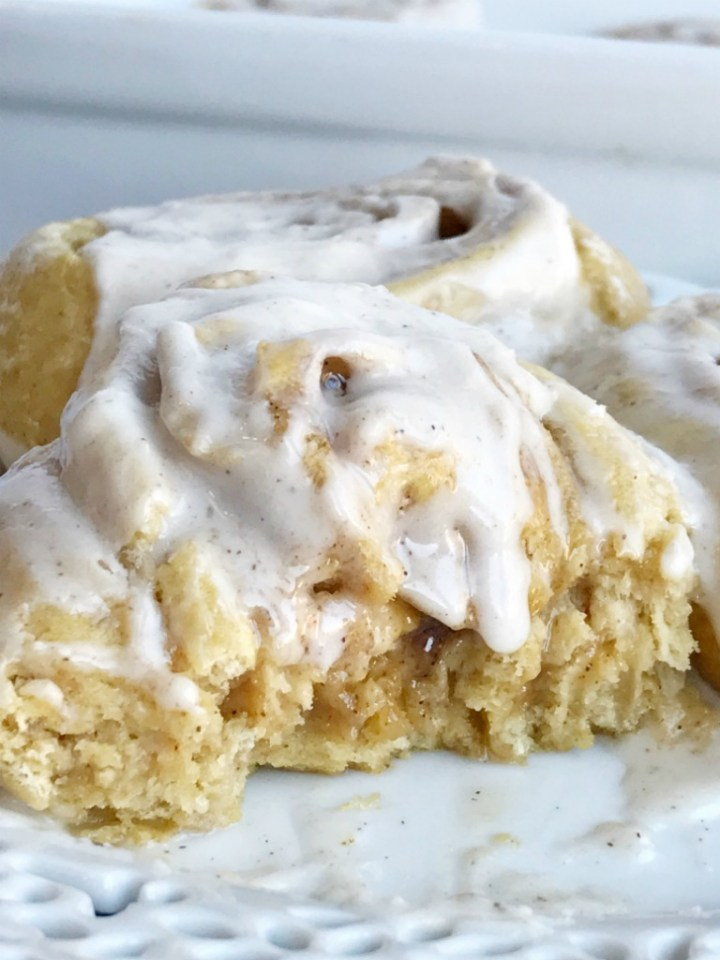 30 minute pumpkin cinnamon rolls are made with no yeast and no eggs! Hot, fresh, gooey cinnamon rolls in 30 minutes. So easy you just might make them all the time. Add in pumpkin and pumpkin spice for the best cinnamon roll you'll ever eat.