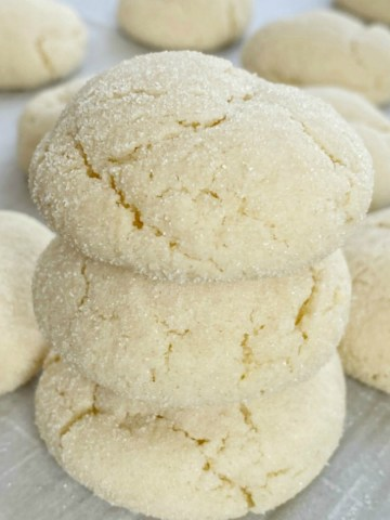 Cake Mix Sugar Cookies are only 5 ingredients, require no rolling and no chilling time, and mix up in just one bowl! Super soft-baked, thick, chewy sugar cookies made so easy with a cake mix. Change up the frosting color and sprinkles for any event or Holiday.
