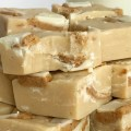 White Chocolate Peanut Butter Reese's Fudge   4 Ingredients is all you need for this deliciously creamy easy white chocolate peanut butter fudge that's loaded with Reese's! Simple ingredients and only 5 minutes of cook time. It's the perfect treat for Christmas cookie plates. You won't believe how silky smooth this fudge is   www.togetherasfamily.com #fudgerecipes #peanutbutterfudge #christmascookies #reesesrecipes #reesesfudge #whitechocolatefudge #whitechocolatefudge #easyfudgerecipe