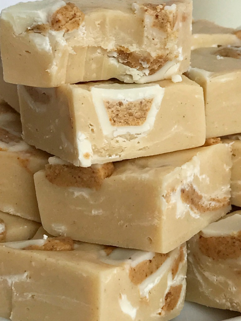 White Chocolate Peanut Butter Reese's Fudge | 4 Ingredients is all you need for this deliciously creamy easy white chocolate peanut butter fudge that's loaded with Reese's! Simple ingredients and only 5 minutes of cook time. It's the perfect treat for Christmas cookie plates. You won't believe how silky smooth this fudge is | www.togetherasfamily.com #fudgerecipes #peanutbutterfudge #christmascookies #reesesrecipes #reesesfudge #whitechocolatefudge #whitechocolatefudge #easyfudgerecipe