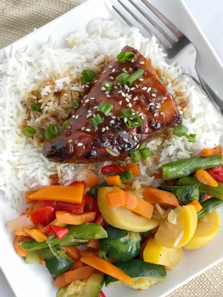4 ingredients are all you need for this super easy & quick dinner recipe! Slow cooker Asian sesame chicken is a family pleasing meal that is loaded with lots of flavor and tender chicken. Serve over hot cooked rice and a side of veggies for an easy dinner that will be gobbled up | www.togetherasfamily.com #crockpotrecipes #slowcookerrecipes #chicken #chickenrecipes #dinner #dinnerrecipes