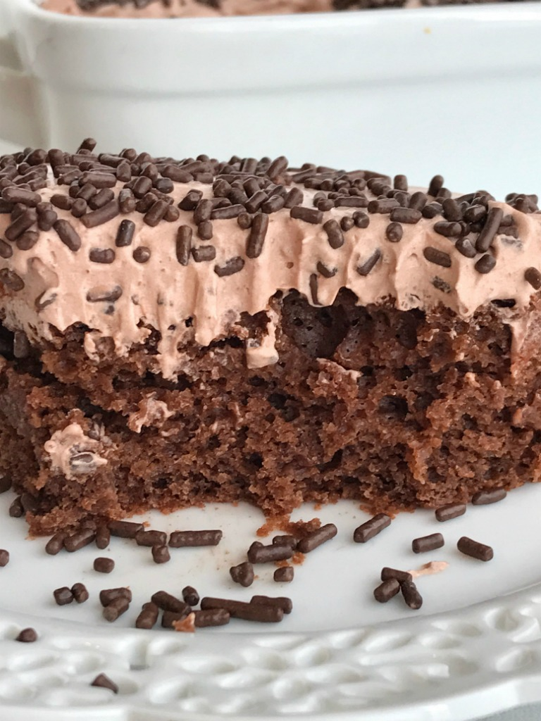 Skinny Chocolate Cake | This skinny chocolate cake is made with a chocolate cake mix, chocolate Greek yogurt and topped with a light & fluffy chocolate whipped frosting! You won't believe that each serving is only 200 calories | Together as Family #healthyrecipes #recipeoftheday #chocolaterecipes #dessertrecipes #recipe #dessert #chocolate #valentinesdayrecipes