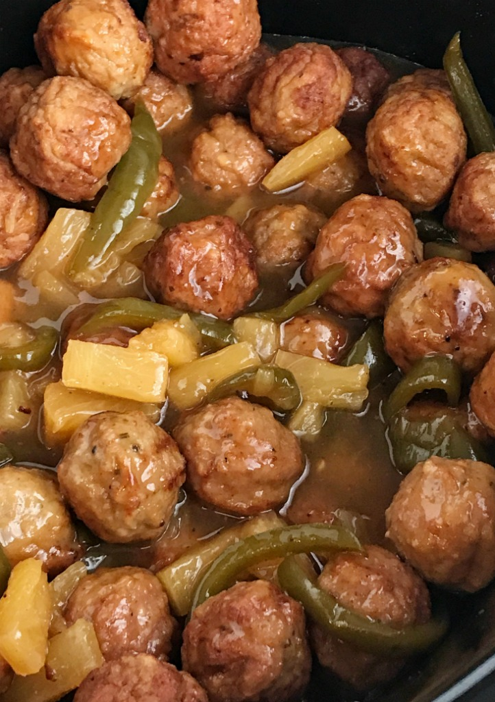Slow Cooker Sweet & Sour Meatballs | Slow cooker sweet sour meatballs are an easy & simple dinner that even the kids will gobble up. Prepared frozen meatballs combine with an easy homemade sweet & sour sauce. Serve over rice for a delicious Asian-inspired dinner | Together as Family #dinnerrecipes #easydinnerrecipes #slowcooker #crockpotrecipes