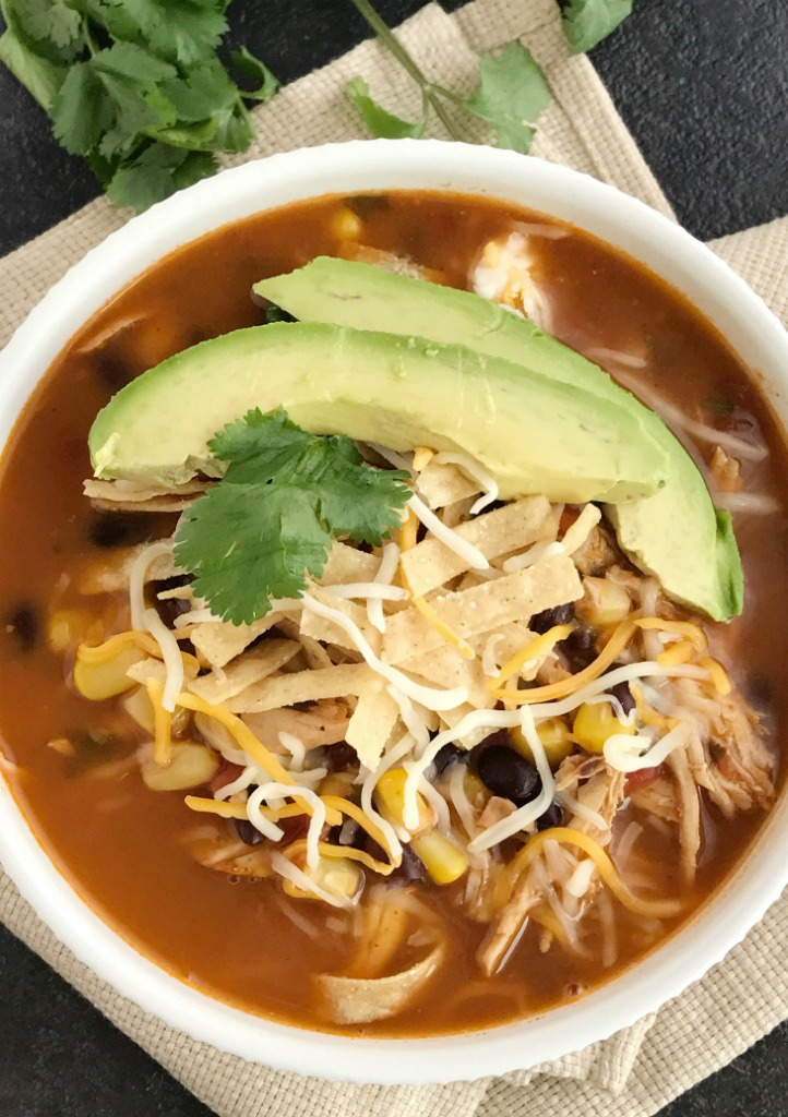 Instant Pot Chicken Tortilla Soup   Healthy chicken tortilla soup made right in an instant pot! It's practically dump n' go and loaded with tender chicken, black beans, tomato, corn, and simmers in the pressure cooker, instant pot, or express cooker. Top with tortilla strips, cheese, and avocado for a healthy and easy dinner   Together as Family #instantpotrecipes #instantpot #pressurecookerrecipes #souprecipes #easydinnerrecipes