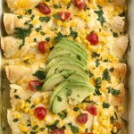 Green Chili Corn Enchiladas   Enchilada Recipes   Chicken Recipes   Mexican Food   Easy Dinner Recipes   Green chili chicken corn enchiladas are an easy family dinner that can be on the table in almost 30 minutes! Use leftover chicken or a rotisserie chicken, canned corn, cheese, and green chili enchilada sauce. Easy and simple ingredients for a delicious dinner recipe #dinnerrecipes #easyrecipes #enchiladarecipes