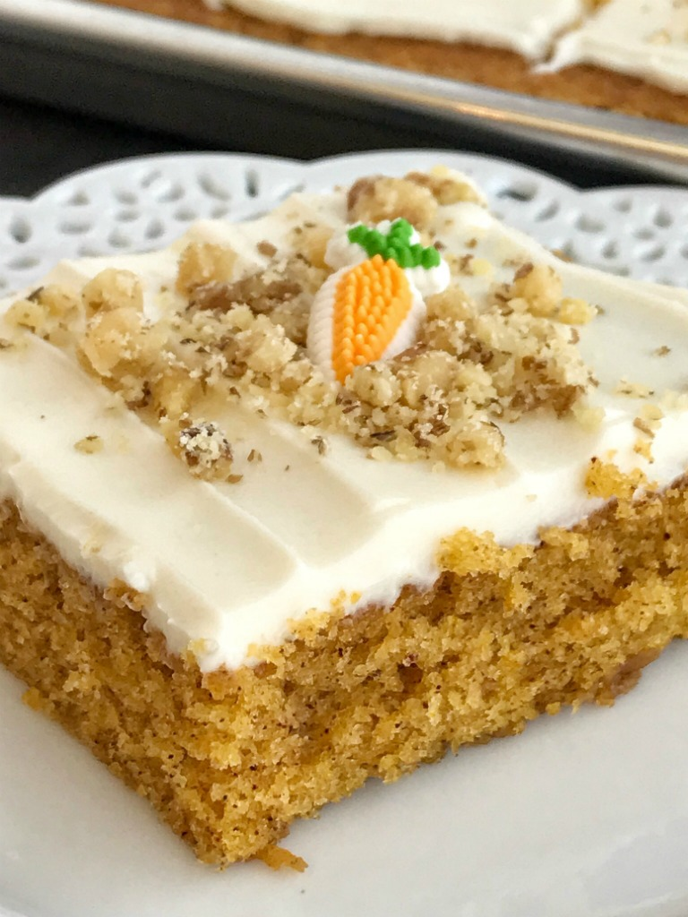 Sheet Pan Carrot Cake Bars | Carrot Cake | Easter Recipes | Easter Dessert | Cake | Sheet Pan | One Pan | Sheet pan carrot cake bars are made with a surprise ingredient that makes them so moist, soft, and easy to make - carrot baby food! No shredding and peeling carrots needed for these delicious carrot cake bars that feed a crowd. Top them with a whipped cream cheese frosting and garnish with chopped walnuts for the best carrot cake dessert.