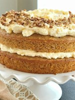 Tropical Layered Carrot Cake w/ Pineapple Pudding Frosting | Try this tropical layered carrot cake for a fun and delicious twist to traditional carrot cake. Carrot cake starts with a boxed cake mix, fresh grated carrots, mandarin oranges and is topped with an incredibly light & fluffy pineapple pudding frosting. Tropical layered carrot cake is just like the famous pig pickin' cake but with a carrot cake twist #easterdesserts #easterrecipes #carrotcake #carrotcakerecipes