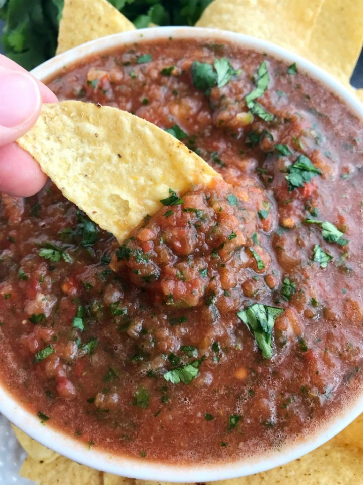 Homemade Blender Salsa | Homemade Salsa | Appetizer | Mexican Food | 10 Minutes | Quick and Easy | This 10 minute homemade blender salsa is so simple & yummy that you will never buy salsa again! Canned whole tomatoes, cilantro, onion, jalapeno, garlic, lime, and seasonings combine for an easy homemade salsa that's made in the blender in only 10 minutes. Serve with chips for an appetizer/snack or use in any recipe that calls for salsa. #easyrecipes #homemade