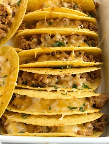 Baked Ground Chicken Tacos   Tacos   Mexican recipes   recipes with ground chicken   Baked ground chicken tacos are an easy, 30 minute dinner recipe! Crispy corn taco shells are filled with tender and flavorful ground chicken with homemade taco seasoning. So much flavor and healthy too! Load up the cheesy crispy tacos with all your favorite toppings #tacos #easydinnerrecipes #dinner #groundchicken #mexicanfood
