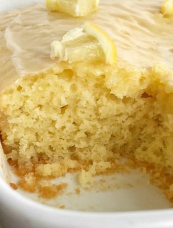Glazed Lemon Yogurt Cake | Lemon Cake | Lemon Desserts | This homemade lemon cake is so moist, tender, soft, and delicious! Yogurt inside the cake and in the glaze on top. This lemon cake is the best dessert for summertime or anytime. #easydessertrecipes #dessert #lemondesserts #lemon