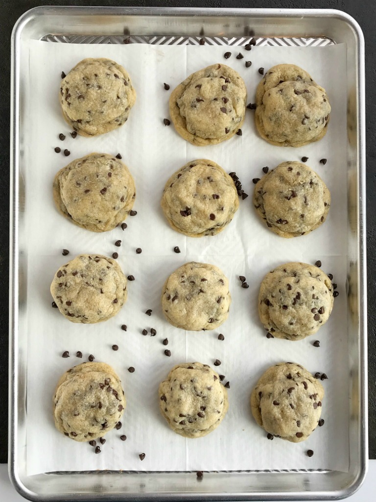 Chocolate Oreo Stuffed Chocolate Chip Cookies | Just when you think the classic chocolate chip cookie couldn't get any better, stuff an Oreo in the middle and it's to die for. Soft-baked, buttery chocolate chips cookies with an chocolate Oreo in the middle #cookierecipes #cookies #oreorecipes